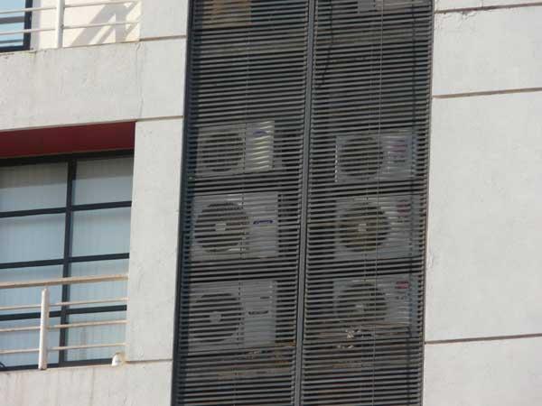 Condensers hidden behind screen.