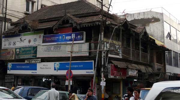 Quintessential Indian residential architecture disappearing under ads.