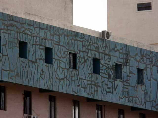 Spiderweb of sealant in cracks in exposed concrete.
